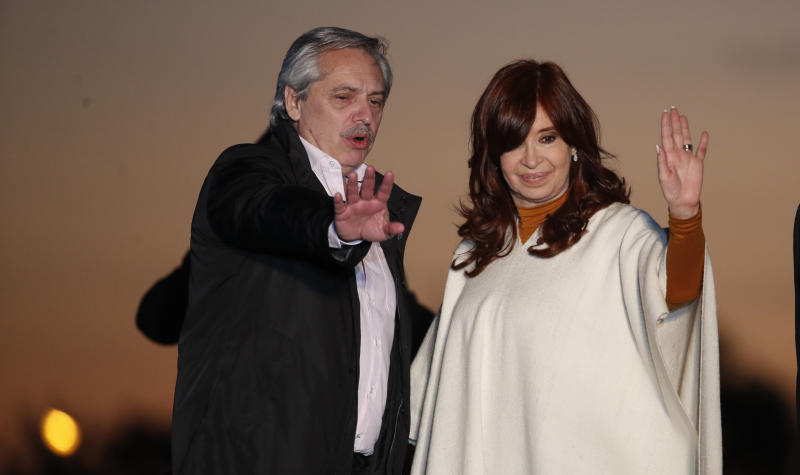 In this Oct. 17, 2019 photo, presidential candidate Alberto Fernandez, left, and running-mate Cristina Fernandez de Kirchner, wave to supporters at a campaign rally in Santa Rosa, Argentina. Fernandez de Kirchner retains immense popularity among Argentines who view her as a champion of the poor. (AP Photo/Natacha Pisarenko)
