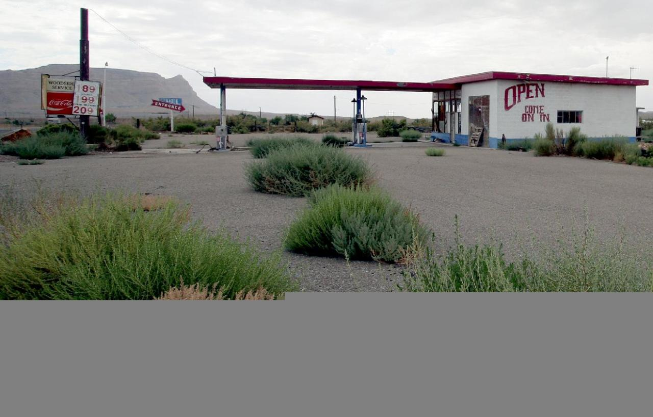 A gas station sits empty in Woodside, Utah, in Emery County on July 27, 2012. The family that owns the 700-acre townsite has put it up for sale. They are seeking $3.9 million. Woodside once bustled with about 300 residents in the early 1900s when it was a water stop for steam engines. Now the town sits empty. (AP Photo/The Deseret News, Geoff Liesik) SALT LAKE TRIBUNE OUT; PROVO DAILY HERALD OUT; MAGS OUT