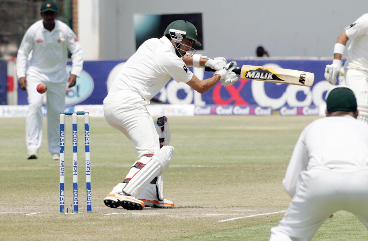 Pakistan batsman Junaid Khan plays a shot during the fifth day of the second test match between Pakistan and hosts Zimbabwe at the Harare Sports Club on September 14, 2013.   AFP PHOTO / JEKESAI NJIKIZANA        (Photo credit should read JEKESAI NJIKIZANA/AFP/Getty Images)