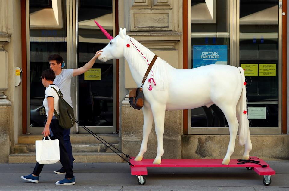A unicorn mock-up, mascot of Vienna's Neos party, is being pulled along a street in Vienna, Austria September 30, 2016. REUTERS/Heinz-Peter Bader
