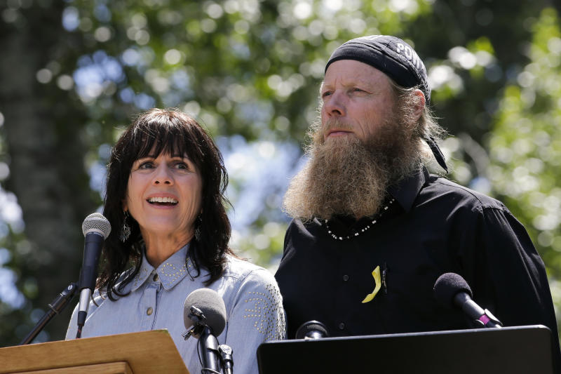 "Jani Bergdahl, left, joined by husband, Bob, the parents of captive U.S. Army Sgt. Bowe Bergdahl, speaks at the ""Bring Bowe Back"" celebration held to honor Sgt. Bergdahl in Hailey, Idaho, Saturday, June 22, 2013. Hundreds of activists for missing service members gathered in a small Idaho town Saturday to hear the parents of the only known U.S. prisoner of war speak just days after his Taliban captors announced they want to exchange him for prisoners being held at Guantanamo Bay. (AP Photo/Jae C. Hong)"