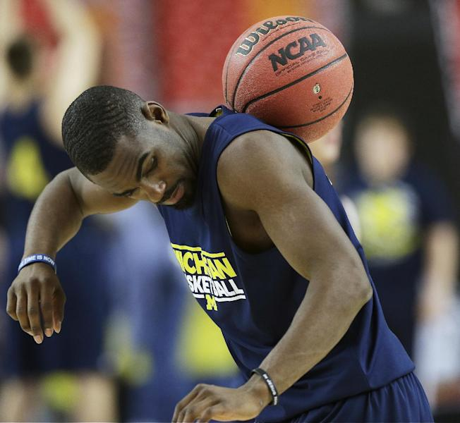 Michigan's Tim Hardaway Jr. works with a ball during practice the NCAA Final Four tournament college basketball semifinal game against Syracuse, Friday, April 5, 2013, in Atlanta. Michigan plays Syracuse in a semifinal game on Saturday. (AP Photo/John Bazemore)
