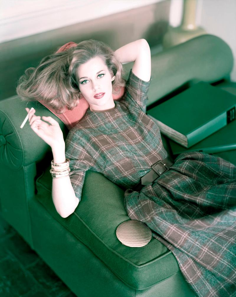 Fonda in a plaid wool dress with brown suede belt.