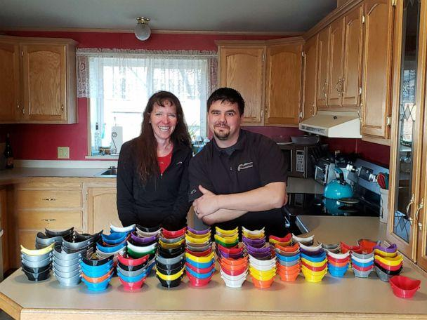 PHOTO: Montana public school teachers Buffy Smith, left, and Jake Spearson, right, are using 3D printers to manufacture plastic face masks for donation to medical and public safety workers facing COVID-19. (Buffy Smith)