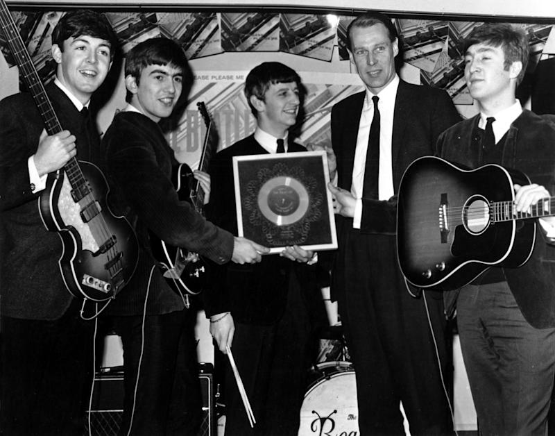 George Martin and the Fab Four hold their silver disk for the debut studio album 'Please Please Me'