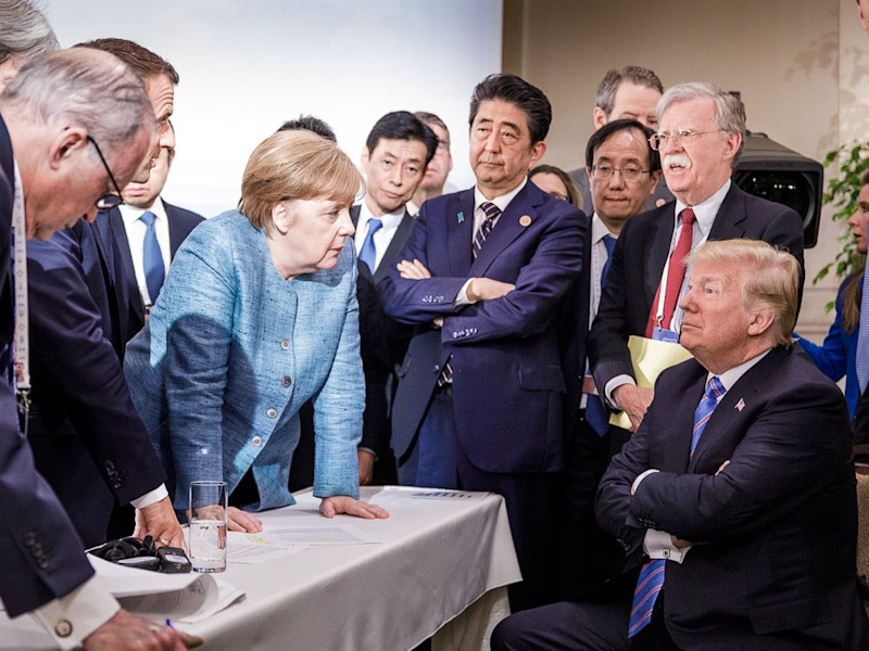 This G7 Summit Photo Of Angela Merkel & Donald Trump Is Meme-Worthy AF