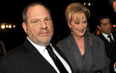 Producer Harvey Weinstein (L) and actress Meryl Streep at an awards ceremony in 2012 - Credit: Kevin Winter