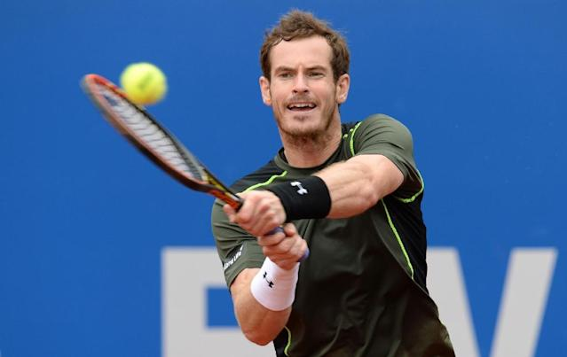 Britain's Andy Murray returns the ball to Lukas Rosol of the Czech Republic during their match at the Munich Open, on May 2, 2015. Murray won the match 4-6, 6-3 and 6-2 (AFP Photo/Christof Stache)