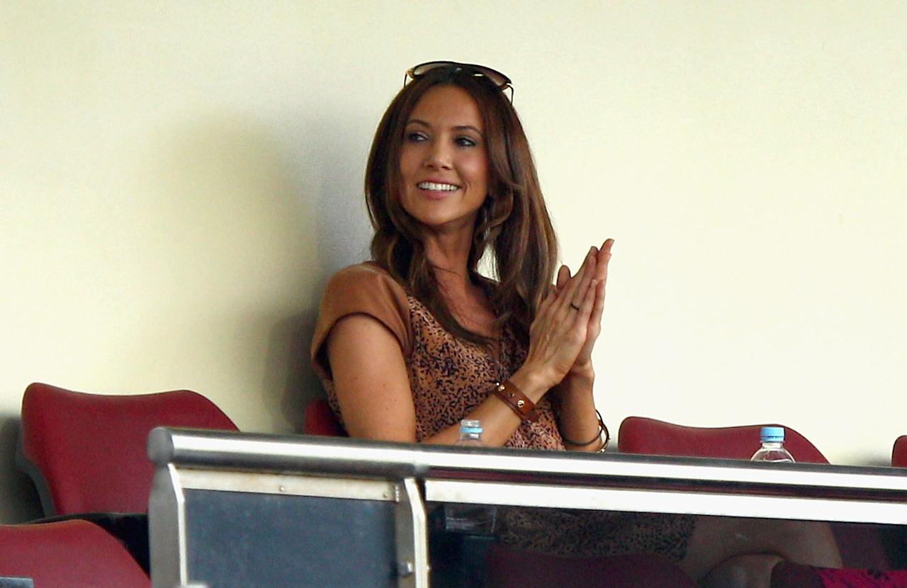 Michael Clarke's then girlfriend Kyly Body cheers him on during his double century against India