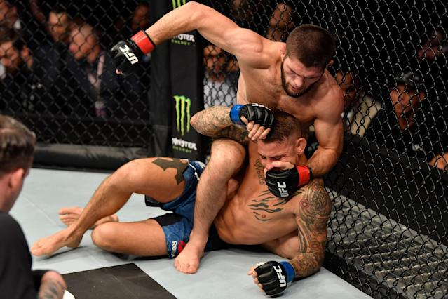 Khabib Nurmagomedov punches Dustin Poirier in their lightweight championship bout during UFC 242 at The Arena on Sept. 7, 2019 in Yas Island, Abu Dhabi, United Arab Emirates. (Getty Images)