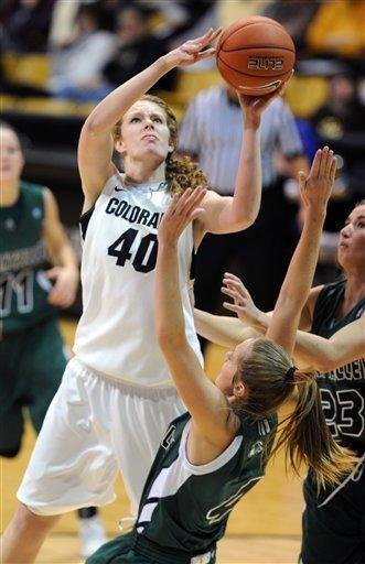 Rachel Hargis of Colorado shoots over Alle Finch Cardwell of Utah Valley during the second half of an NCAA college basketball game Saturday Dec. 22, 2012 in Boulder, Colo. (AP Photo/Daily Camera, Cliff Grassmick)