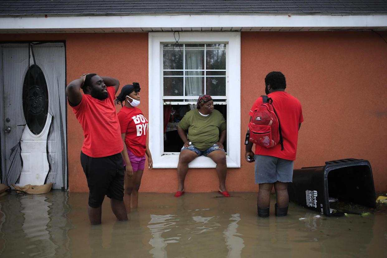 Residents wait to be rescued by first responders from floodwaters in LaPlace, La., on Monday.