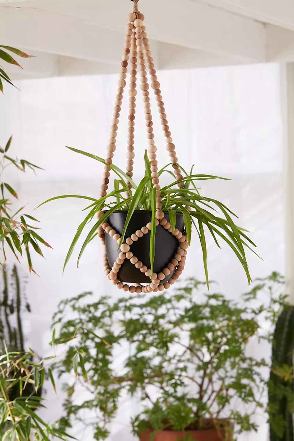 """<h2>Urban Outfitters Beaded Hanging Planter</h2><br>Upgrade your living space with a sweet hanging pot crafted from wooden beads that will easily complement a variety of interiors.<br><br><strong>Urban Outfitters</strong> Beaded Hanging Planter, $, available at <a href=""""https://go.skimresources.com/?id=30283X879131&url=https%3A%2F%2Fwww.urbanoutfitters.com%2Fshop%2Fbeaded-hanging-planter2"""" rel=""""nofollow noopener"""" target=""""_blank"""" data-ylk=""""slk:Urban Outfitters"""" class=""""link rapid-noclick-resp"""">Urban Outfitters</a>"""