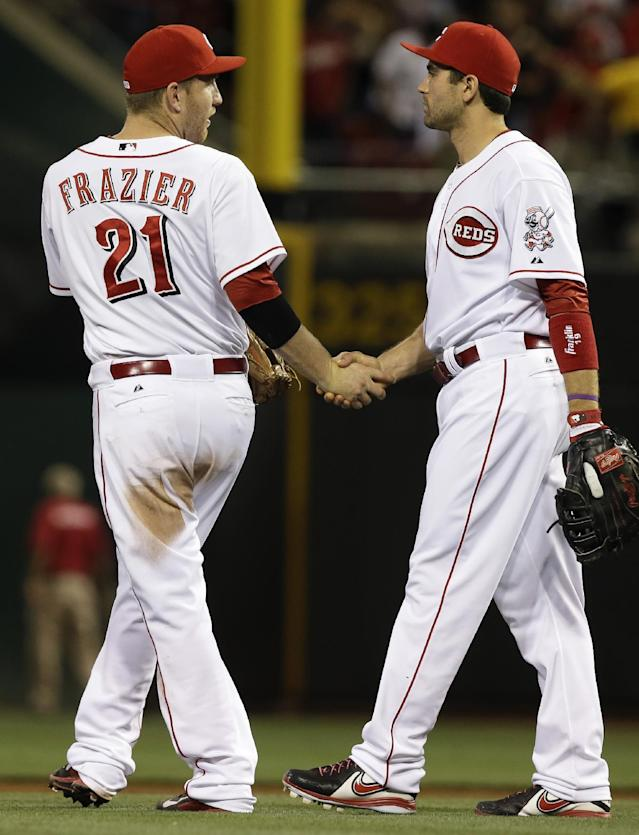Cincinnati Reds' Todd Frazier (21) is congratulated by Joey Votto after the Reds defeated the St. Louis Cardinals 1-0 in a baseball game, Tuesday, Sept. 3, 2013, in Cincinnati. Frazier drove in the only run of the game with a double. (AP Photo/Al Behrman)