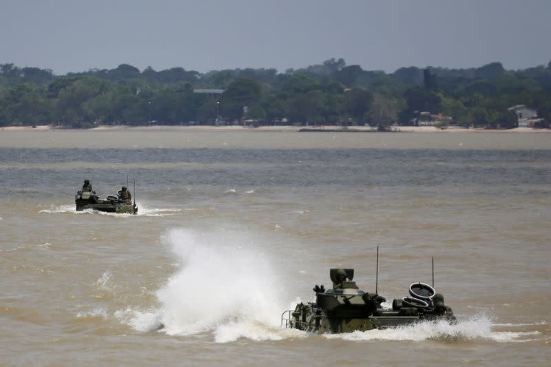 "Amphibious vehicles are seen during military exercises, called ""Agata"" operation, near a multipurpose amphibious ship Bahia"