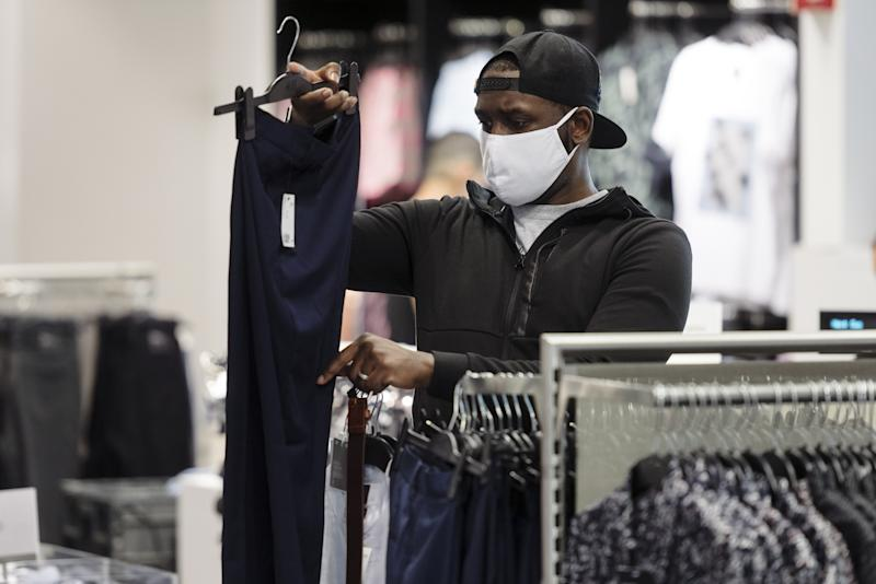 A customer wearing a protective mask shops at a Hennes & Mauritz (H&M) clothing store at Westfield San Francisco Centre in San Francisco, California, U.S., on Thursday, June 18, 2020. (Michael Short/Bloomberg via Getty Images)