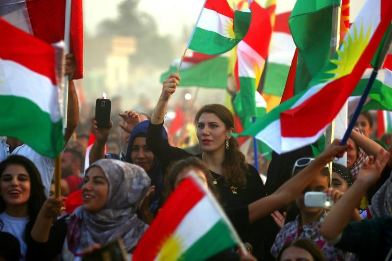 Syrian Kurds take part in a rally in Qamishli on September 15, 2017 in support of a planned independence referendum by Iraqi Kurds
