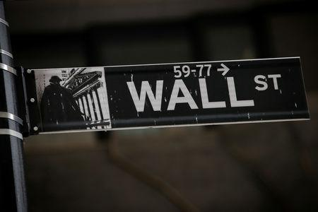 A Wall St. street sign is seen near the New York Stock Exchange (NYSE) in New York City, U.S., March 7, 2019. REUTERS/Brendan McDermid