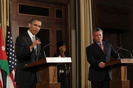 Jordan's King Abdullah speaks during a joint news conference with U.S. President Barack Obama at Al-Hummar Palace in Amman