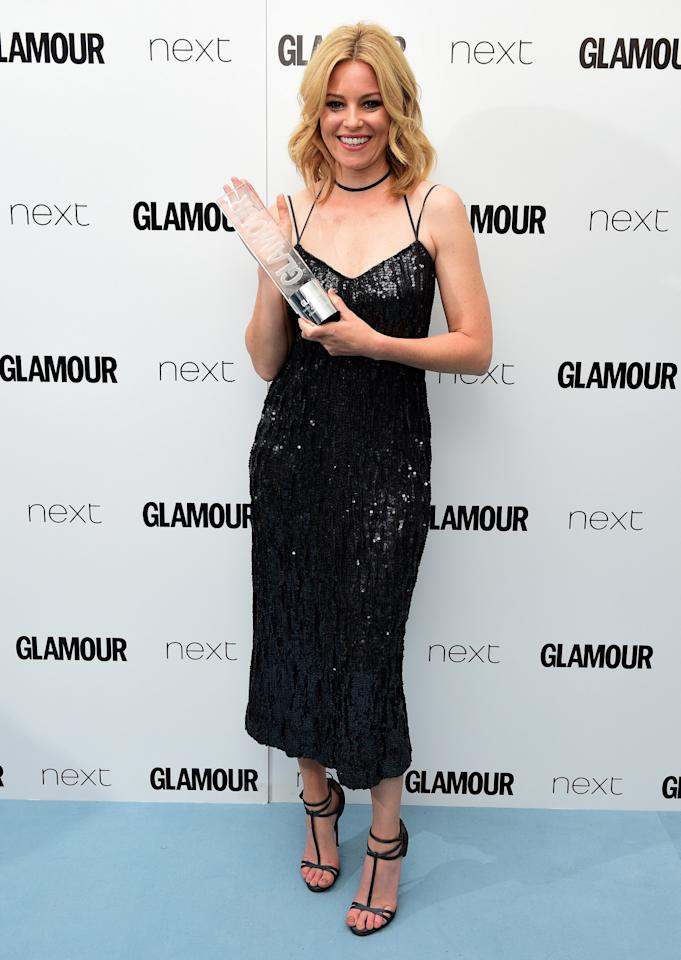 "<p>The ""Hunger Games"" actress opted for a sequin covered LBD, which showed off her toned arms.<i> [Photo: PA Images]</i></p>"