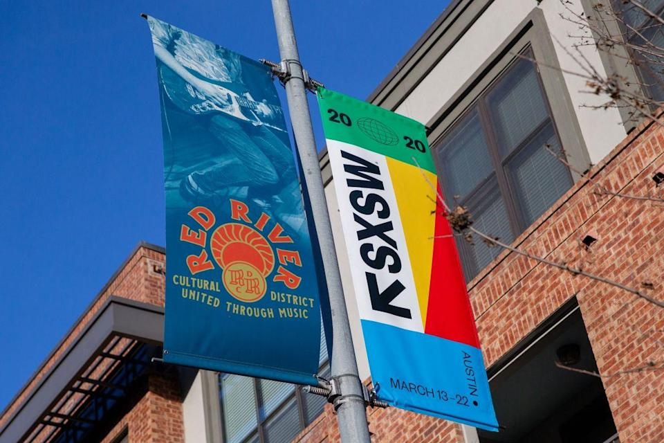 SXSW 2020 banners are seen in the Red River Cultural District on March 6, 2020 in Austin Texas.