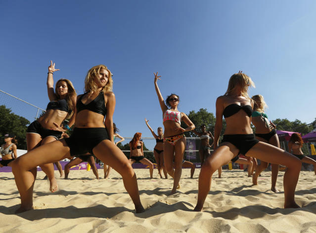 Dancers rehearse their performances for the London 2012 Olympic Beach Volleyball matches at the practice facility near to Horse Guards Parade in London July 24, 2012. REUTERS/Luke MacGregor (BRITAIN - Tags: SPORT VOLLEYBALL OLYMPICS)