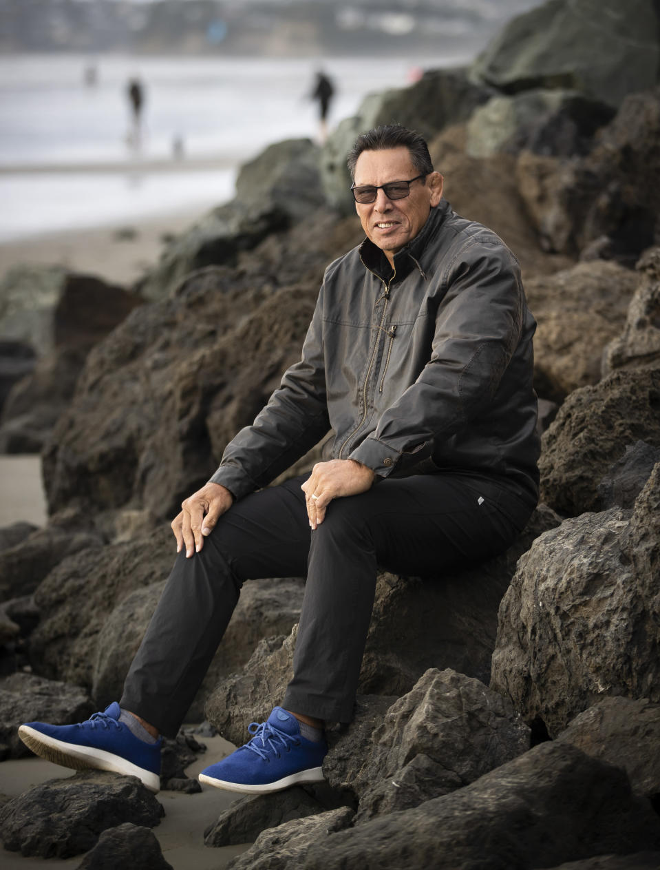 """Retired All Blacks captain Wayne Shelford poses for a photo in Orewa north of Auckland, New Zealand, Saturday, June 5, 2021. The former All Blacks captain Wayne """"Buck"""" Shelford has been knighted in the New Zealand civil honors list commemorating the Queen's Birthday public holiday. (Brett Phibbs/NZ Herald via AP)"""
