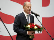 Olaf Scholz, top candidate for chancellor of the Social Democratic Party (SPD), attends a press statement at the party's headquarter in Berlin, Germany, Monday, Sept. 27, 2021. The center-left Social Democrats have won the biggest share of the vote in Germany's national election. They narrowly beat outgoing Chancellor Angela Merkel's center-right Union bloc in a closely fought race that will determine who succeeds the long-time leader at the helm of Europe's biggest economy. (AP Photo/Michael Sohn)