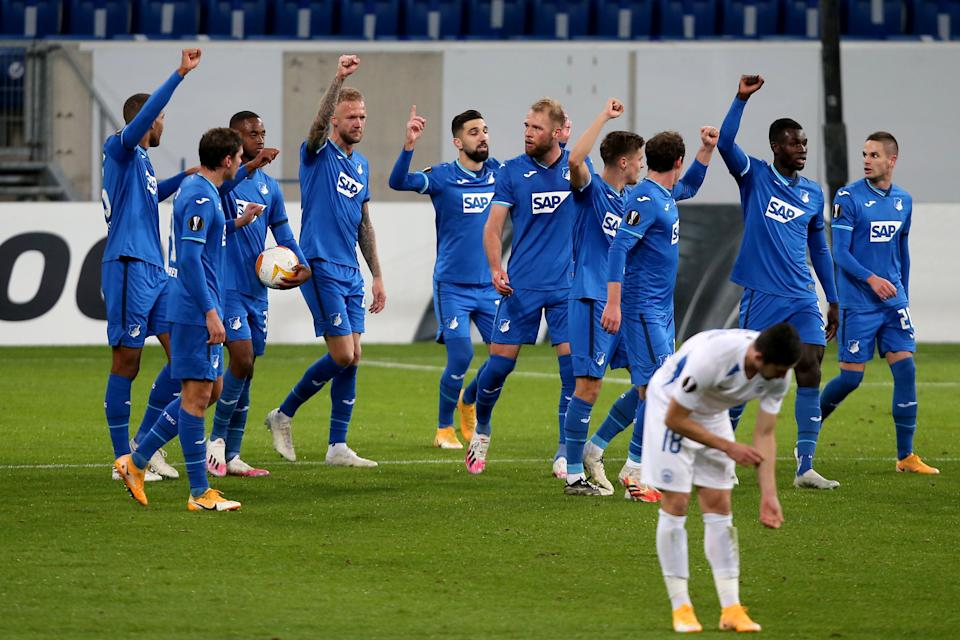 Hoffenheim's players show solidarity with teammate Ryan Sessegnon, who was racially abused on social media earlier this week, during Thursday's Europa League match against Slovan Liberec. (Harry Langer/Getty Images)