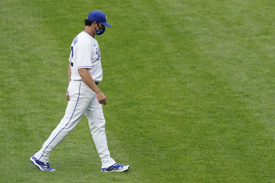 Kansas City Royals manager Mike Matheny walks to the dugout after making a pitching change during the first inning of a baseball game against the Chicago White Sox Saturday, May 8, 2021, in Kansas City, Mo. (AP Photo/Charlie Riedel)