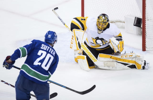 Pittsburgh Penguins goalie Casey DeSmith, right, stops Vancouver Canucks' Brandon Sutter during the second period of an NHL hockey game in Vancouver, British Columbia, Saturday Oct. 27, 2018. (Darryl Dyck/The Canadian Press via AP)