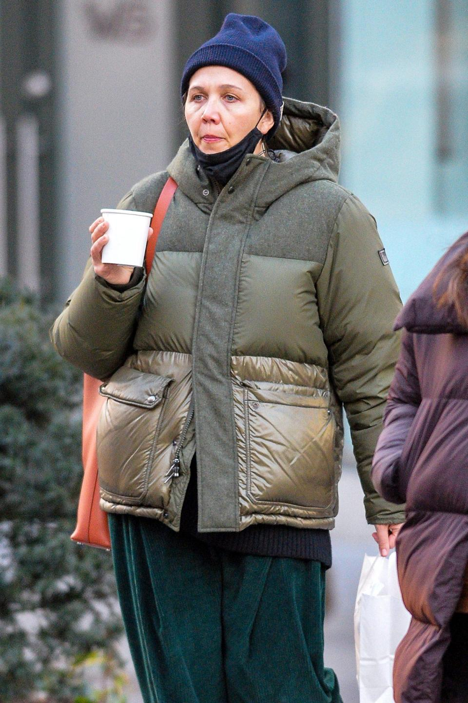 <p>Maggie Gyllenhaal stays toasty under her warm layers (and with a hot drink) on Thursday in N.Y.C.</p>