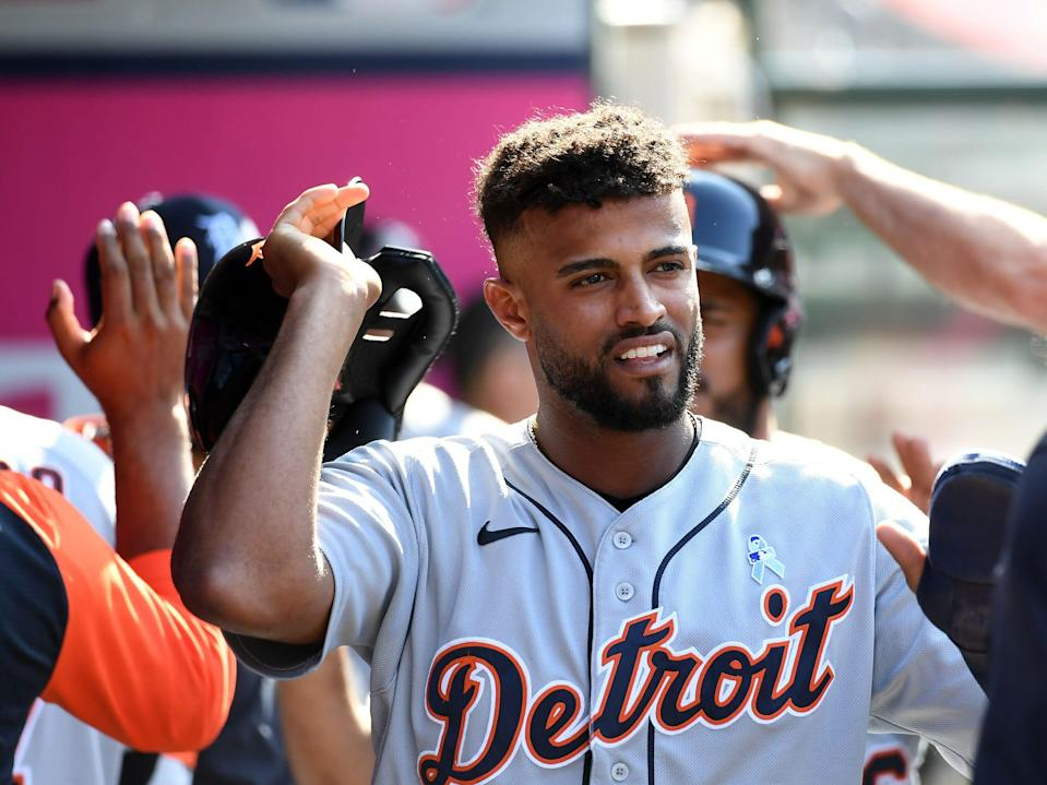 Detroit Tigers shortstop Willi Castro (9) is greeted after scoring a run against the Los Angeles Angels during the tenth inning at Angel Stadium in Anaheim, California, on Sunday, June 20, 2021.