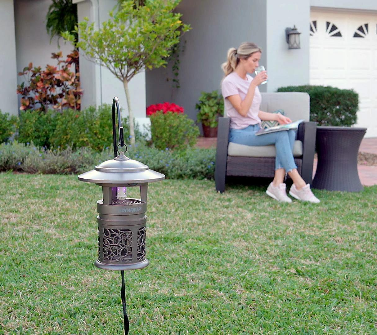 With the DynaTrap on duty, she'll never again be tortured by biting insects. Now if only someone would show her how to sit in that chair... (Photo: QVC)