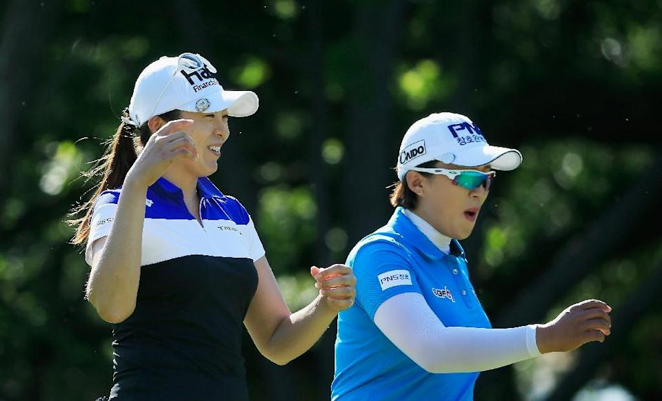 Hur Mi-Jung (L) and Amy Yang of South Korea walk off the 14th tee during the third round of the Texas Shootout at Las Colinas Country Club on April 30, 2016 in Irving (AFP Photo/Scott Halleran)