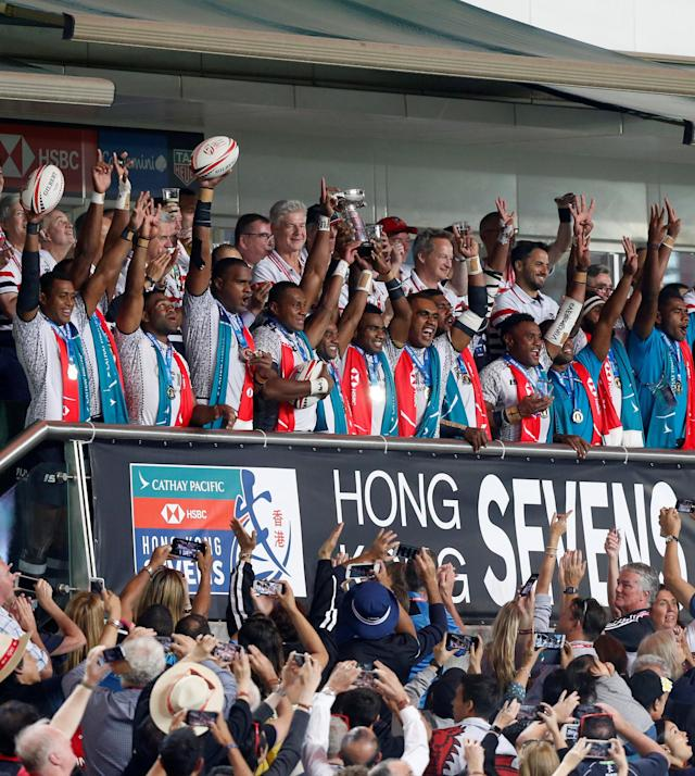 Rugby Union - Fiji v Kenya - World Rugby Sevens Series - Hong Kong Stadium, Hong Kong, China - April 8, 2018 - Fiji players celebrate with trophy after winning the final. REUTERS/Bobby Yip