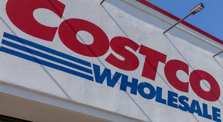 Costco (COST) logo on a sign on a Costco store.