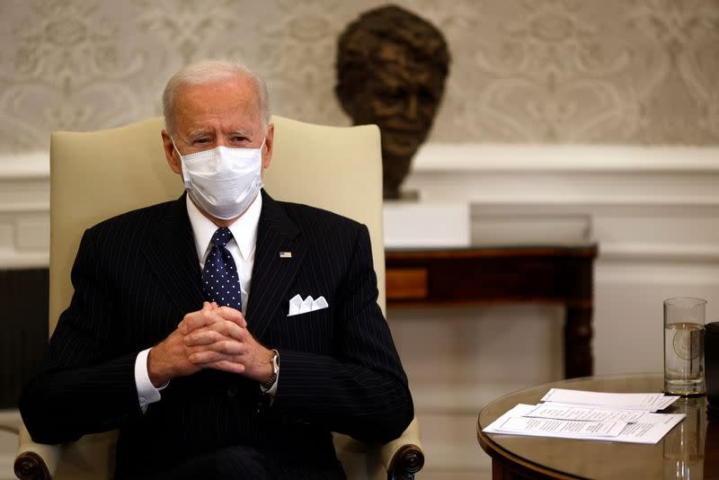 FILE PHOTO: U.S. President Joe Biden accompanied by U.S. Vice President Kamala Harris and Treasury Secretary Janet Yellen (not pictured) attends a meeting with business leaders at the Oval Office of the White House in Washington, U.S.