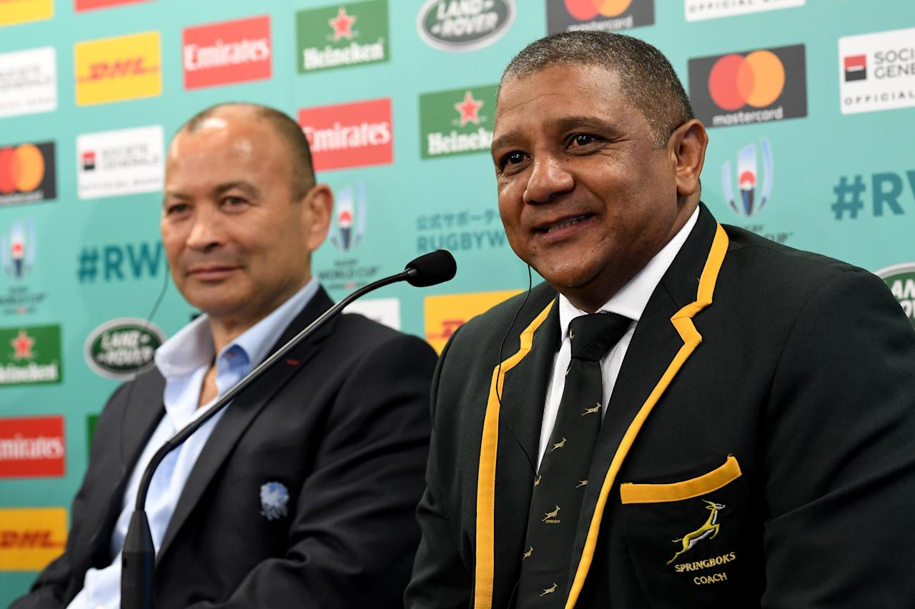 South Africa's head coach Allister Coetzee (R) speaks beside England's head coach Eddie Jones during their press conference following the Rugby World Cup Japan 2019 pool draw at Kyoto state guesthouse in Kyoto on May 10, 2017. (AFP Photo/Toshifumi KITAMURA)