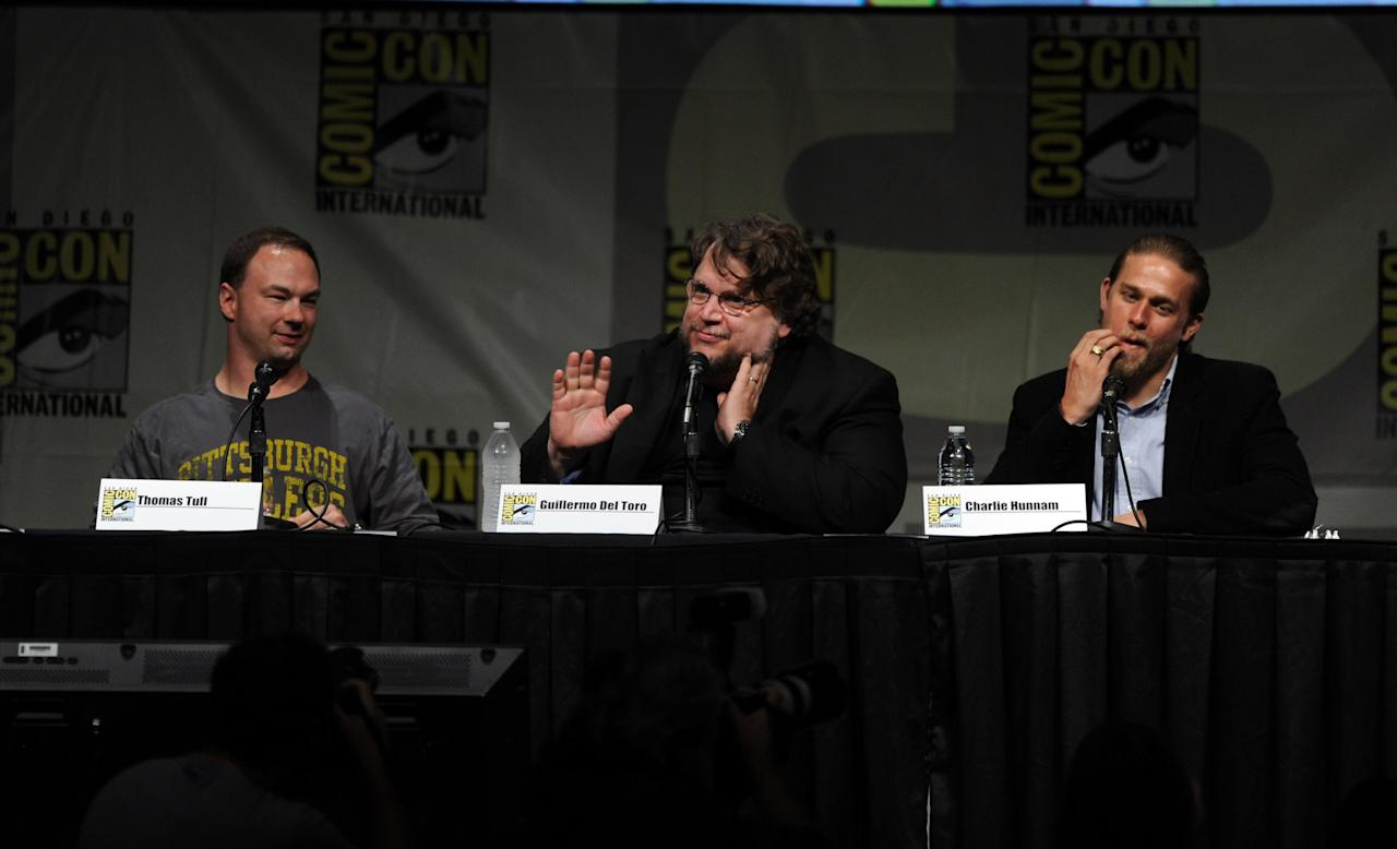 """SAN DIEGO, CA - JULY 14:  Producer Thomas Tull, director Guillermo del Toro, and actor Charlie Hunnam speak at Warner Bros. Pictures and Legendary Pictures Preview of """"Pacific Rim"""" during Comic-Con International 2012 at San Diego Convention Center on July 14, 2012 in San Diego, California.  (Photo by Kevin Winter/Getty Images)"""