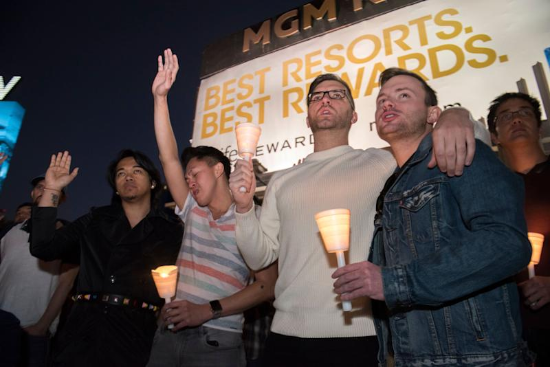 Mourners show support during a candlelight vigil.
