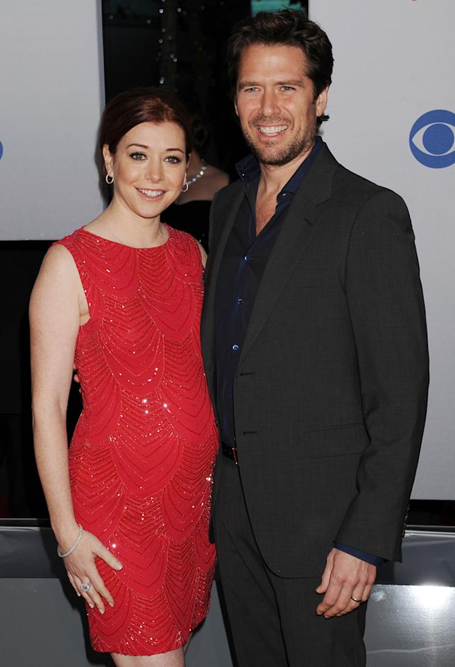 "While Alexis Denisof has appeared on wife Alyson Hannigan's sitcom ""How I Met Your Mother,"" fans will tell you that the couple actually met during the 1999-2000 season of ""Buffy and the Vampire Slayer."" (She played Willow Rosenberg; he was Wesley Wyndam-Pryce.) In 2003, he popped the question and they tied the knot later that year. ""Our single friends have told us that they hope to find the kind of love we have someday,"" the actress told <a href=""http://www.womansday.com/life/how-she-does-it-alyson-hannigan-101480"" target="">Woman's Day</a>. Sounds like they have something pretty special!"