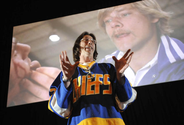 "FILE - In this Dec. 13, 2012, file photo, Steve Carlson, who portrayed Steve Hanson in the cult classic ""Slap Shot,"" talks about his experiences while making the film in 1977, during a showing of the movie for its 35th anniversary in Johnstown, Pa. ""Slap Shot"" was No. 5 in The Associated Press' Top 25 favorite sports movies poll. (John Rucosky/The Tribune-Democrat via AP, File)"
