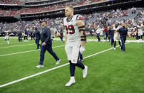 Houston Texans defensive end J.J. Watt (99) walks across the field with coach Bill O'Brien, left after an NFL football game against the New York Giants Sunday, Sept. 23, 2018, in Houston. The Giants won 27-22. (AP Photo/Eric Christian Smith)