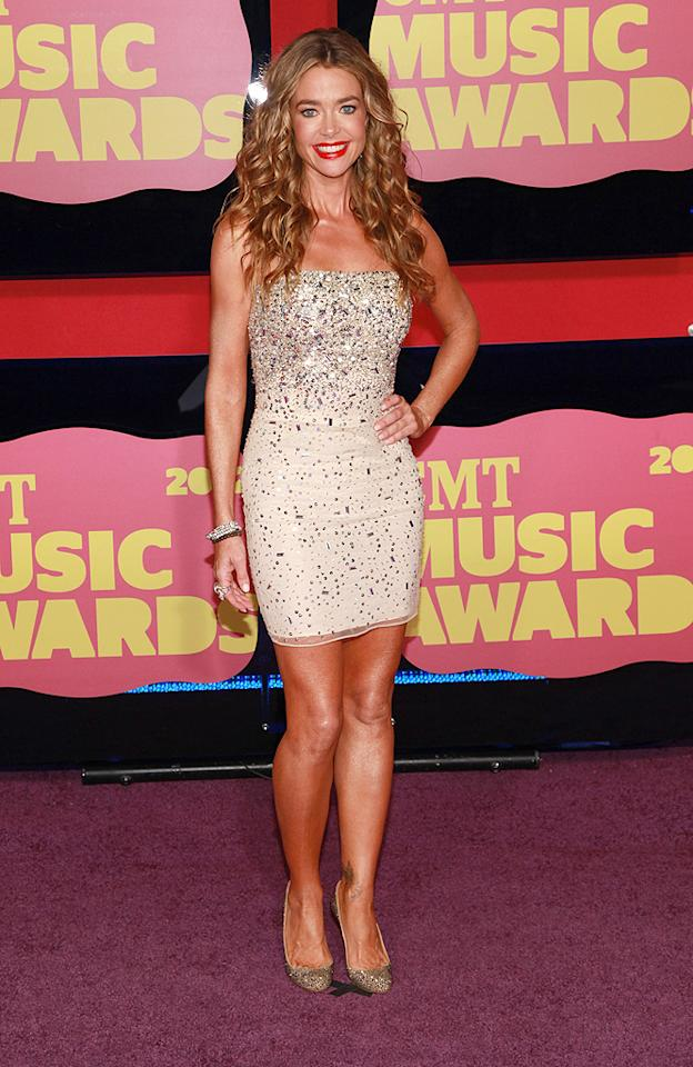 "<p class=""MsoNormal"">She's not a country singer, but Denise Richards certainly looked the part thanks to her very sparkly mini and her long blond curls. The actress was at the event with her on-again boyfriend, Bon Jovi guitarist Richie Sambora, although they were careful not to pose together on the red carpet.</p>"