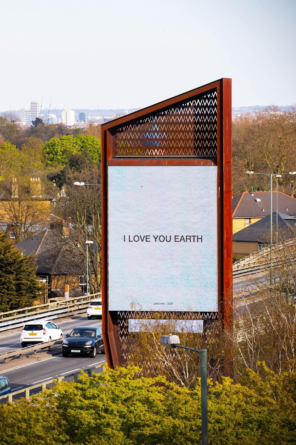 Yoko Ono's artwork I Love You Earth on the Chiswick Towers' digital billboards in West London by Serpentine, with ClearChannel (David Parry/PA)