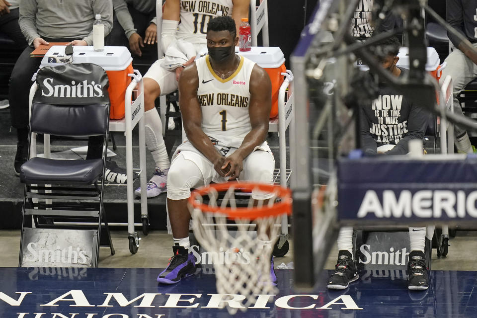 New Orleans Pelicans forward Zion Williamson (1) sits on the bench during the first half of the team's NBA basketball game against the Utah Jazz on Tuesday, Jan. 19, 2021, in Salt Lake City. (AP Photo/Rick Bowmer)