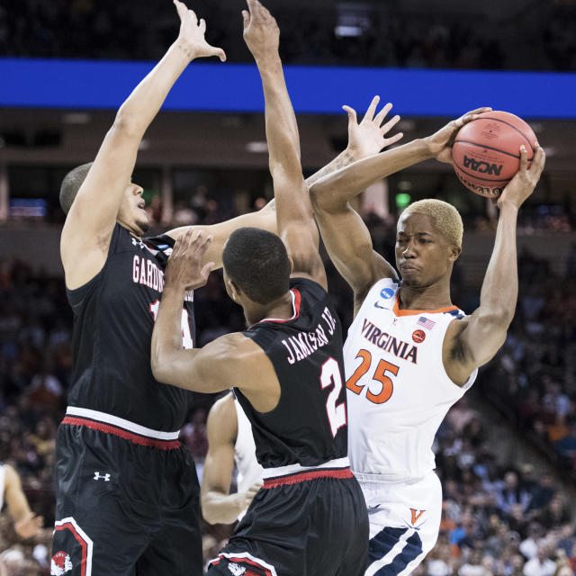 Virginia forward Mamadi Diakite (25) attempts a move against Gardner-Webb forward Eric Jamison Jr. (2) and Brandon Miller, left, during a first-round game in the NCAA mens college basketball tournament Friday, March 22, 2019, in Columbia, S.C. (AP Photo/Sean Rayford)