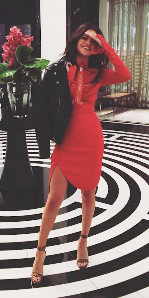 <p>The singer was spotted out in New York City on Valentine's Day wearing a red hot dress and animal print sandals. She topped off her outfit with a cool black leather jacket.</p>