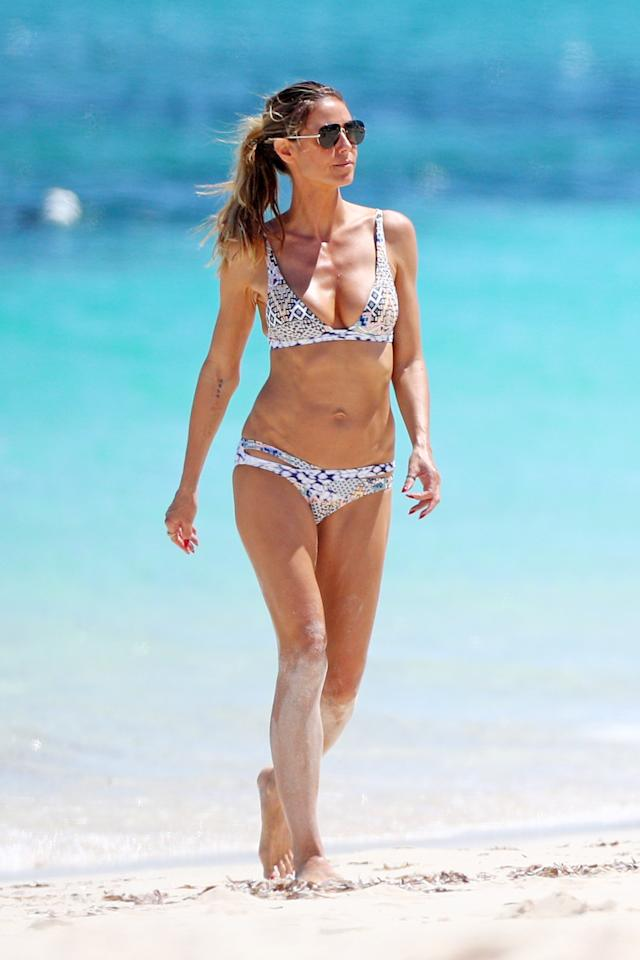 <p>The <em>Project Runway </em>host showed off her killer bod in a patterned bikini while soaking up the sun in Turks and Caicos. </p>